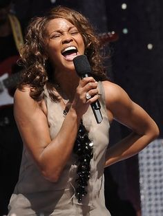 In this September 1, 2009 file photo, Whitney Houston performs on Good Morning America in New York's Central Park.