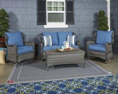 Abbots Court - Blue/Gray Rust free aluminum with resin wicker Durable Nuvella solution dyed polyester fabric Loveseat glider includes two throw pillows Wood look resin top coffee tabl