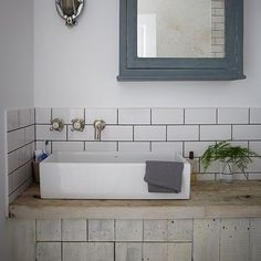 Industrial-style bathroom with metro tiles | Living room decorating | Livingetc | Housetohome.co.uk  Industrial-style bathroom with metro tiles Optimise a small space in your bathroom with wall-mounted taps and a counter-top sink. The cupboard underneath provides storage space.