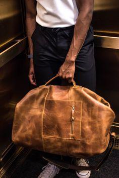 Leather travel sac.