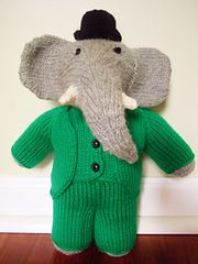"Babar toy, by Sara Elizabeth Kellner - free Ravelry download. ""This pattern is available as a free Ravelry download - ""Babar stands 11 inches tall. He is knit in the round with worsted weight yarn, and in one piece from the neck down, so there is very little seaming required.  Instructions for Babar (with trunk pointing up or down, your choice), his green suit, a bowler hat, king's cape, and crown all included."""