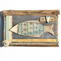 'Big Fish' by Shirley Vauvelle is a highly original 3D collage built from layers of driftwood, reclaimed maps, vintage shipping forecast chart and interesting beach finds complete with a quirky earthe