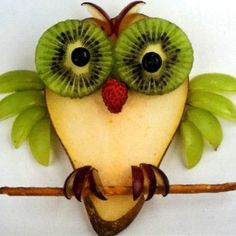 Fruit Owl - body is a slice of pear, eyes kiwi & blueberries, nose a raspberry, wings green grapes, feet & eye brows red grapes, and a pretzel stick