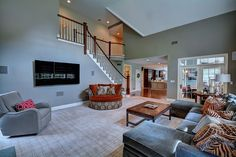 Transitional Living Room with High ceiling, TV Wall Mount, Carpet ~ Love the stairwell