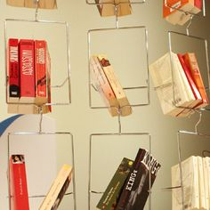 """Floating Bookshelf """"SALKIM"""". I like the idea of a closet full of books rather than clothes and shoes. 5 'hangars' for 90 Euros."""