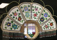 Beautiful beaded Fan hanging at the Community Government building of Gameti, Northwest Territories made by Lucy Ann Takazo.