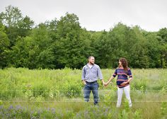 Alex and Kristin maternity image in open field, red sox colors, Rhode Island Maternity Photography Amy Ro Photography