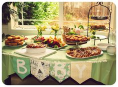baby-shower-brunch table spread Kim, I don't like the baby banner, but I do like the colors and the rest of it.
