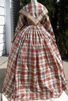 "back: 1860s Brown Plaid Silk Dress Partial 2nd Bodice Pelerine or Fichu Pagoda Sleeves | eBay seller mrandmrsciv; fichu trim of 3.25"" ribbons; front hook & eye closure; boned in two darts on either side, brown cotton lining, sleeves lined w/ white cotton, faced w/ pale pink silk; evening bodice - back hook & eye closure, white cotton lining, boned; box-pleated skirt, tight gauging in back, white cotton lining, tan wool hem binding; bust: 35""; waist: 24"" skirt length: 44-48""; hem width…"