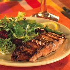 Salmon usually does quite well unadorned, but this hot and sassy marinade makes this grilled salmon even more delicious. with lots of zippy ingredients like balsamic vinegar, crushed red peppers, ginger and soy sauce, you can 't go wrong.