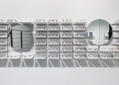 Sunglasses Display - This Ace & Tate boutique by Occult Studio is both a retail space and eyewear gallery—its sunglasses displays are uniquely shaped to highl. Floating Glass Shelves, Glass Shelves Kitchen, Visual Merchandising, Fendi, Fabric Covered Walls, Glass Store, Eyewear Shop, Ray Bans, Retail Interior Design