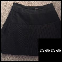 Bebe ❤️Pinstriped Skirt Bebe pinstriped skirt ❤️worn once for modeling❤️like new🚫trades❤️paid$79❤️bundle❤️please use offer button via all offers❤️thank you💋 bebe Skirts Mini