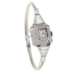 Uti Lady's Platinum, White Gold and Diamond Bracelet Watch | From a unique collection of vintage wrist watches at http://www.1stdibs.com/jewelry/watches/wrist-watches/