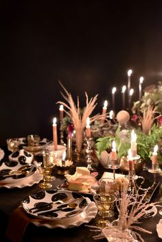 Delight guests this Halloween with an enchanting tablescape by mixing everyday pieces with spooky décor elements. Soirée Halloween, Halloween Table, Coton Colors, Spooky Decor, Tablescapes, Candles, Table Decorations, Create, Cotton