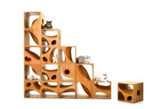 presented as four wooden cubes, each with different holes and can be stacked and adapted to fulfill the needs of the owner and their pet(s).