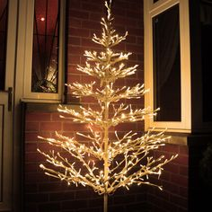 Battery, mains and solar powered lights for Christmas or all year use.  Beautiful LED tree ...
