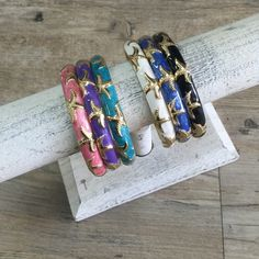 """HWN004 Beautifully crafted, Hawaiian bangles.  Gold tone with hand painted enamel designs. this bracelet features a starfish. Fits wrist sizes 6.5"""" - 8.5"""" because of the wide hinge opening for easy on and off Ocean Jewelers Jewelry Bracelets"""