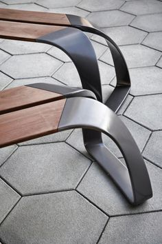 Furniture detail: wood + black metal, beautiful bench.