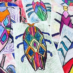 First grade symmetrical insect drawings. Thanks @artwithlee for the beetle inspiration! We used black oil pastel to make a symmetrical insect rubbing. Then we used texture plates for our background crayon rubbings.