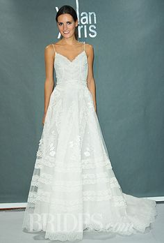 """Brides.com: Our Favorite Lace Wedding Dresses from the Bridal Runways. """"Guetaria"""" sleeveless lace A-line wedding dress with a scalloped v-neckline and spaghetti straps, YolanCris  See more A-line wedding dresses."""