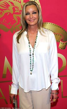 She's still a 10! Bo Derek, 56, looks breathtaking in a white blouse and cream trousers at TV party
