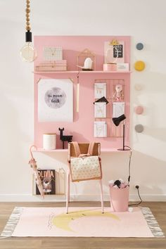 In this space they have gone for one pastel tone with a few small accents of other colours. The result is a very pretty and girly desk space. We're loving the dotty wall hooks which complete the space perfectly.