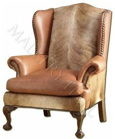 """Custom-made leather chair with a hint of animal print on back and sides. Specifications: Width: 39"""", Depth: 35"""", Ht: 45"""""""