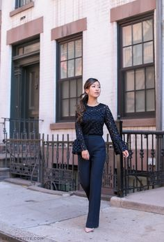 Professional style // To look longer & leaner, try dark boot cut pants with a high waist that hit floor length. All outfit details on extrapetite.com