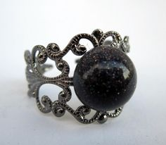 Victorian Style Antiqued Silver Adjustable Filigree Ring with Blue Goldstone Cab $10.00