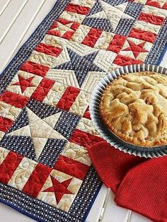 MY PATRIOTIC TABLE RUNNER by Jean Nolte: Learn how to create unique stars without using templates when you select this pattern. Our Sew Easy instructions for making stars help you piece the project efficiently. Table Runner And Placemats, Table Runner Pattern, Quilted Table Runners, Table Topper Patterns, Patchwork Table Runner, Flag Quilt, Patriotic Quilts, Patriotic Crafts, Patriotic Decorations