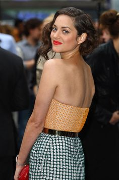 Marion Cotillard basically kicked the *ss of the coral lipstick she wore to the London premiere of The Dark Knight Rises. She showed it who's boss.