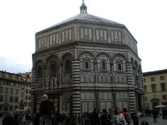Florence Baptistry (Battistero di San Giovanni)   Built in Romanesque style between 1059 and 1128.  Exquisite colored marble.  Beautiful bronze, paneled doors by Andrea Pisano and Lorenzo Ghiberti mark the entrances to the Baptistry.  This building was magnificent, as we're the doors.