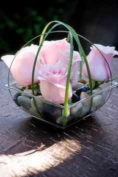 Simple, DIY centerpieces. Just anchor the Lily Grass under the rocks. #pamelaseventdesign.com #DIY wedding ideas