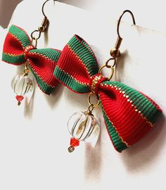 Red green and gold Christmas bow beaded earrings by BeadingByJenn, $10.00 #jewelry #earrings #Christmas #bows #xmas #red #green #gold #holidays #etsy #handmade #shopping #cute