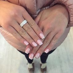 The classical French manicure is made here on the base of the enamel pink nail polish. The nails of the