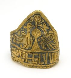 Ring of Æthelwulf (Noble Wolf), King of Wessex, 828-858, Anglo-Saxon. richly decorated with religious symbols, and inscribed Æthelwulf Rex. Found in  Laverstock in a cart rut in 1780.