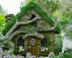 A Celtic inspired tree of life fairy house photographed in a miniature fairy garden.