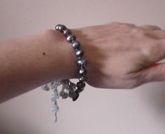 Grey pearl bracelet with silver coloured hand made crochet ribbons and mother of pearls button by MazeOfLace on Etsy