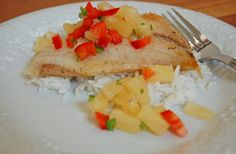 Tilapia with pineapple salsa and coconut rice.  The picture does not do this meal justice... it's amazing.  A favorite!