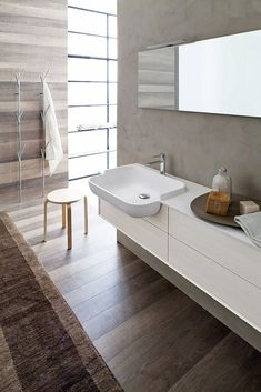 This Contemporary Bathroom incorporated Neutral Colors for a Relaxing Spa Experience - this roll under sink adds function for a Universal Design