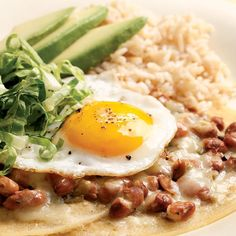 "Huevos rancheros or ""ranch eggs"" is a classic Mexican dish that is great for a quick dinner. Traditionally, it's made with a red tomato-based sauce. Here we use tart and tangy green salsa instead. Serve with: brown rice and slices of avocado."