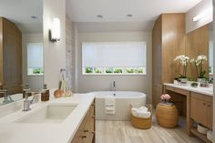 Need to relax after a hard week? This divine #masterbathroom with Pure White #countertops by Charlie & Co. Design, Ltd. might be the perfect spot! #interiordesign #Caesarstone #quartz #bath #kitchen #renovation #modernhome