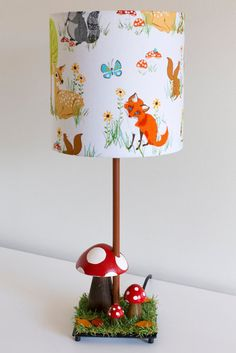 Woodland nursery toadstool lamp with woodland creatures barrel lamp shade featuring fox, deer and racoon