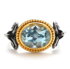 """Lika Behar's """"Ramona"""" ring features a sky blue topaz gem with 24k yellow gold beading and an oxidized silver band, at Greenwich Jewelers  $1595"""