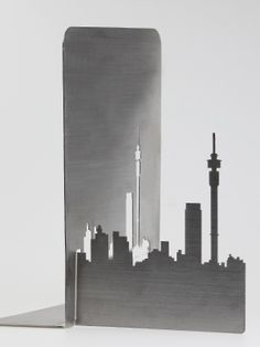 Stainless steel bookends of the Joburg skyline by Fanie van Zyl. Johannesburg Africa, Johannesburg Skyline, Weekend Trips, Day Trips, Africa Craft, Awesome Stuff, Bookshelves, Bookmarks, South Africa
