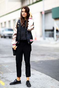 Love how this street style pro wears her bomber jacket, black trousers, and lace-up flats.