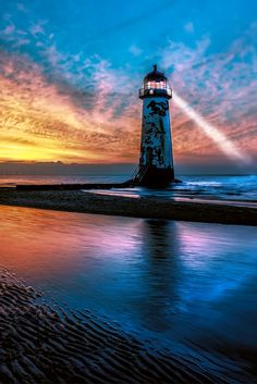 Light House Sunset by Adrian Evans - Explore the World with Travel Nerd Nici, one Country at a Time. http://TravelNerdNici.com
