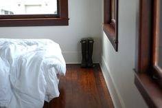 white walls, dark trim and dark wood floors