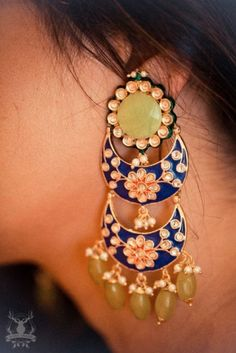 Wear for a haldi or day function with hair pulled back or on one side on light chiffon or a light material attire.