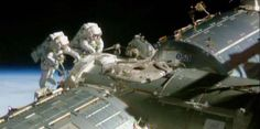 Astronauts Barry Wilmore (left) and Terry Virts outside the International Space Station during a successful spacewalk on Feb. 20.